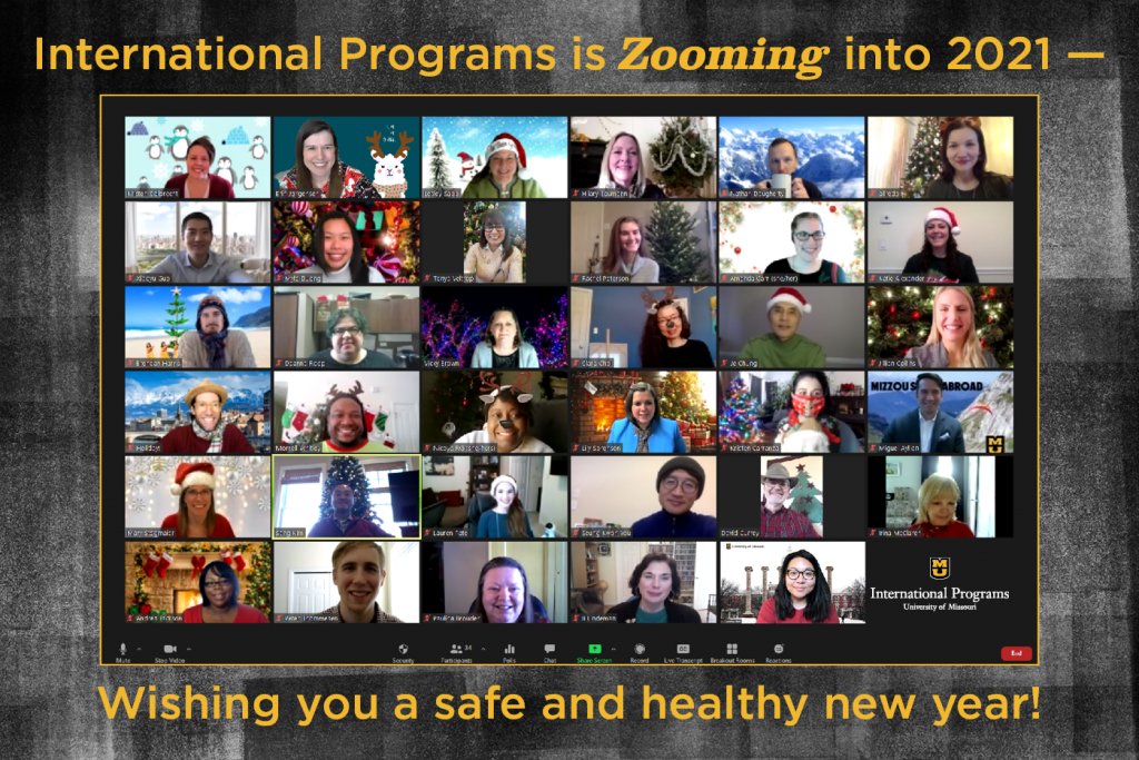Screenshot of a Zoom meeting of 35 people in various festive attire and backgrounds. Text says 'International Programs is Zooming in 2021 - wishing you a safe and healthy new year!'