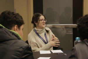 Photograph of Ana Šućur, a Global UGRAD World Learning Granting, sitting at a table and talking with other students during the spring 2020 international student welcome event. January 2020.