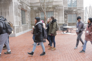 Alyssa Neesha Swee Lynn Yau, Ana Šućur and and Abnen de la Cruz Perdomo explore campus with volunteers during international student welcome spring 2020. They are walking past Ellis library and looking around.