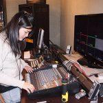 Volunteer operates a sound board