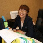 Smiling volunteer works at a desk