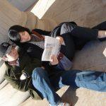 Students look at a brochure
