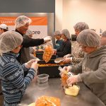 Participants volunteer at the local food bank