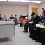 Participants engage in a classroom discussion