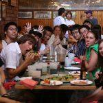 Students and ambassadors enjoy dinner together