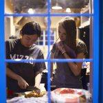A student and ambassador prepare food together