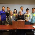 Participants in the Asian Scholars and Global Leadership Programs pose with two instructors