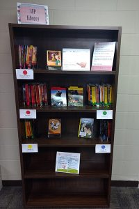 A bookshelf holding the IEP Library books and materials.