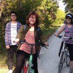 Three people on bikes pose on the Katy Trail.